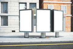 Blank white three billboards on empty street in the afternoon, m Stock Images