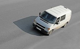Blank white van on road Royalty Free Stock Image