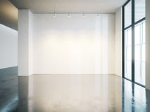 Blank white wall in gallery with concrete floor Stock Photos