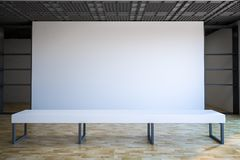 Blank white wall in gallery hall. Loft style empty exhibition white blank banner in gallery with white bench on parquet floor. 3D rendering Royalty Free Stock Photos