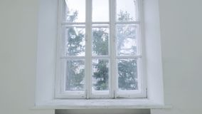 Blank white wall with window. Slide motion of movement or hitting the camera on empty light white room with window. Construction Home Empty room interior Royalty Free Stock Photos