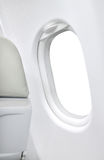 Blank white window plane and gray seat Royalty Free Stock Image