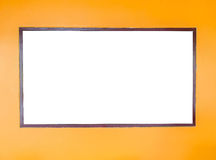 Blank White Wooden Frame on Orange Wall used as Template Stock Images