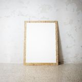 Blank white wooden natural frame on a cocrete wall Royalty Free Stock Photo