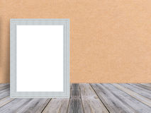 Blank white wooden photo frame at tropical plank wooden floor and wall. Royalty Free Stock Photography