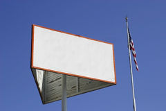 Blank white wooden sign. Next to an american flag Royalty Free Stock Photos