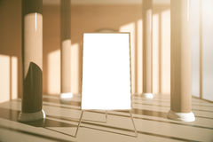 Blank whiteboard in interior. Blank whiteboard stand in interior with columns, sunlight and shadows. Mock up, 3D Rendering Stock Photos