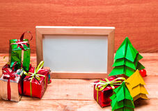 Blank whiteboard for your text on wooden background. Royalty Free Stock Photos