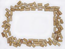 Blank Wine Corks Creating a Frame Against a White Background royalty free stock images
