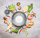 Blank Wok pan and ingredients for Chinese or Thai cooking , top view. stock photos