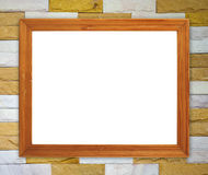Blank wood frame on brick stone wall Royalty Free Stock Images