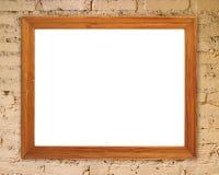 Blank wood frame on brick stone wall Royalty Free Stock Photo