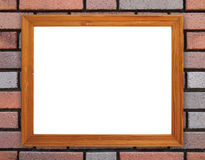 Blank wood frame on brick stone wall Stock Photography