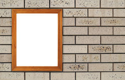 Blank wood frame on brick stone wall Royalty Free Stock Photos