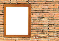 Blank wood frame on brick stone wall Stock Images