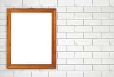 Blank wood frame on brick stone wall Stock Image