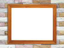 Blank wood frame on brick stone wall Stock Photography