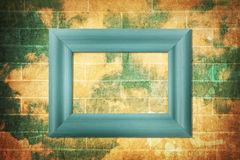 Blank wood frame on brick wall Stock Photography