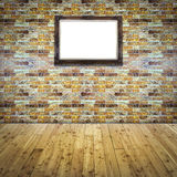 Blank wood frame on tile brick wall Royalty Free Stock Images