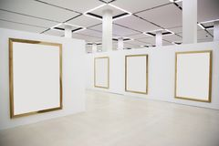 Blank wood frames in hall. Wood frames on the white wall Stock Images