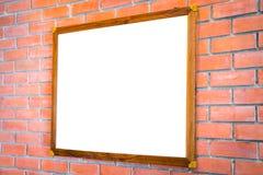 .Blank wood sign on brick wall Stock Image