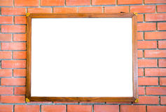 .Blank wood sign on brick wall Royalty Free Stock Photography
