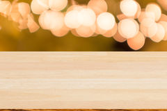 Blank wood table top with blurred bokeh background. Royalty Free Stock Photo