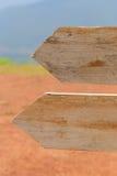 Blank wooden arrow guidepost. Stock Photos