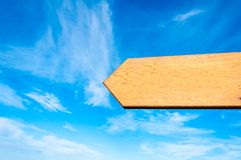 Blank wooden arrow over clear blue sky with copy space Royalty Free Stock Photo