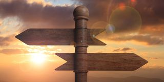 Wooden pointer signposts on pole, isolated on sunset background. 3d illustration. Blank wooden arrow signposts on pole, isolated on sunset sunrise background. 3d Stock Photos