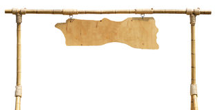 Blank wooden board hanging from bamboo frame with ropes isolated royalty free stock photos