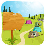 Blank wooden board standing near campsite Royalty Free Stock Photos