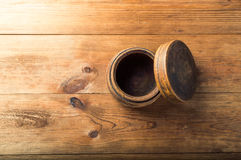 Blank wooden bowl on table background, top view.  Royalty Free Stock Photo