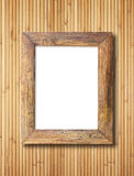 Blank wooden frame on bamboo wall Stock Images