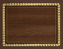 Blank wooden frame and border trimmed with gold ribbon. 3d illustration.  Royalty Free Stock Photography