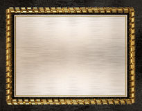 Blank wooden frame and border trimmed with gold ribbon. 3d illustration Royalty Free Stock Photography