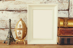Blank wooden frame, next to old books. template Royalty Free Stock Photography