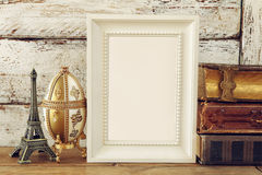 Blank wooden frame, next to old books. template Stock Photos