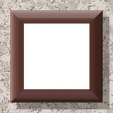Blank wooden frame on patterned wall Stock Image