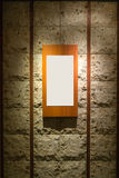 Blank wooden frame on stone wall royalty free stock images