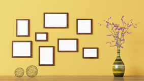 Blank wooden frames over yellow wall 3d rendering Stock Images