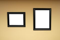 Blank wooden frames on Wall Stock Photo