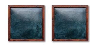 Empty wooden frames on the wall. Blackboards inside and white background, space for text. Blank wooden frames on the wall. Blackboards inside and white stock photos