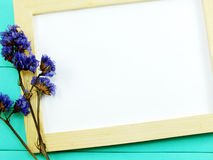 Blank wooden photo frame and dried flowers valentine day Stock Images