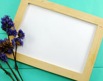 Blank wooden photo frame and dried flowers valentines day Stock Photo