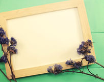 Blank wooden photo frame and dried flowers valentines day Stock Image
