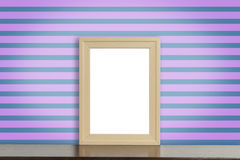 Blank Wooden photo frame on a funky purple strip Royalty Free Stock Image