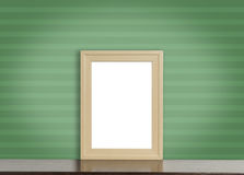 Blank wooden photo frame on green stripe Royalty Free Stock Photo
