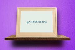 Blank wooden Photo frame on purple royalty free stock image