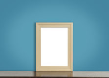 Blank wooden photo frame on rustic navy background. Stock Photos